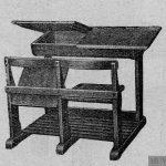 Mesa-banco bipersonal con cajones.