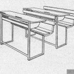 Mesas bipersonales de asiento fijo.